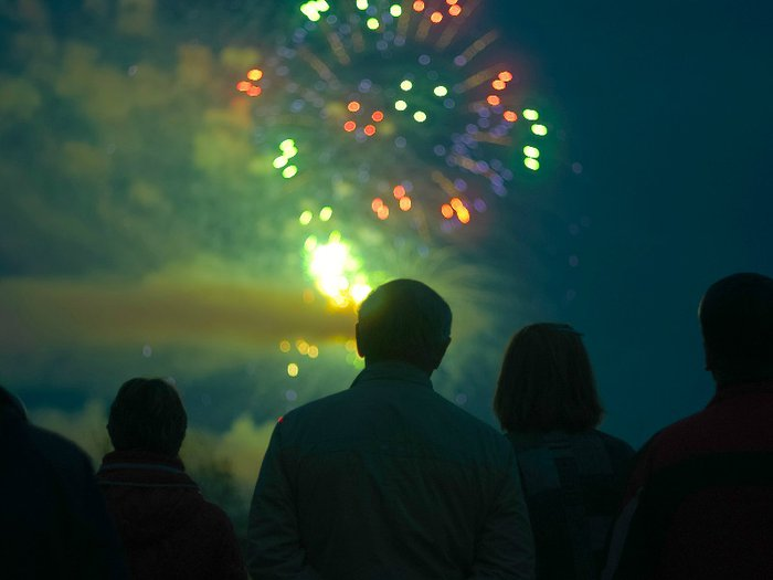 Mourners watch a firework display as part of an alternative funeral