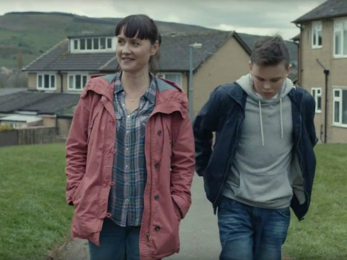 Shot from the McDonald's advert, showing mother and son walking together