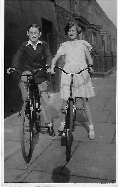 Frank age 11 with mabel on their immaculate bikes thanks to their father's early experience as a bicycle mechanic