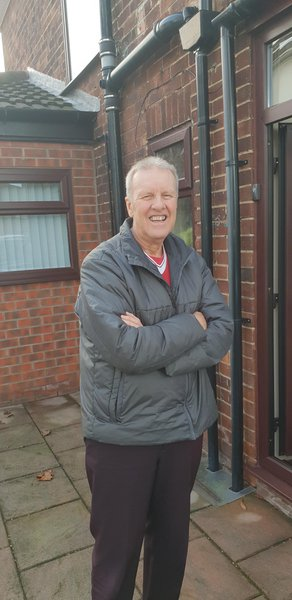 Dad outside his old house in Liverpool