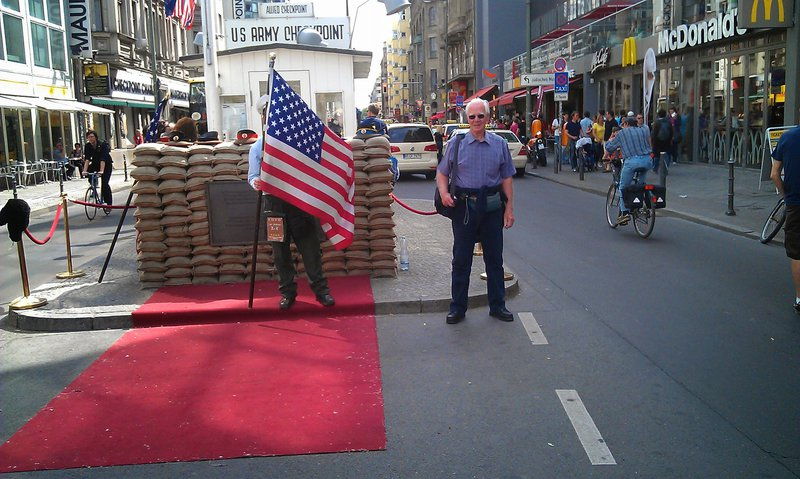 Dad at checkpoint Charlie. Berlin trip with Paul and Andy May 2012.