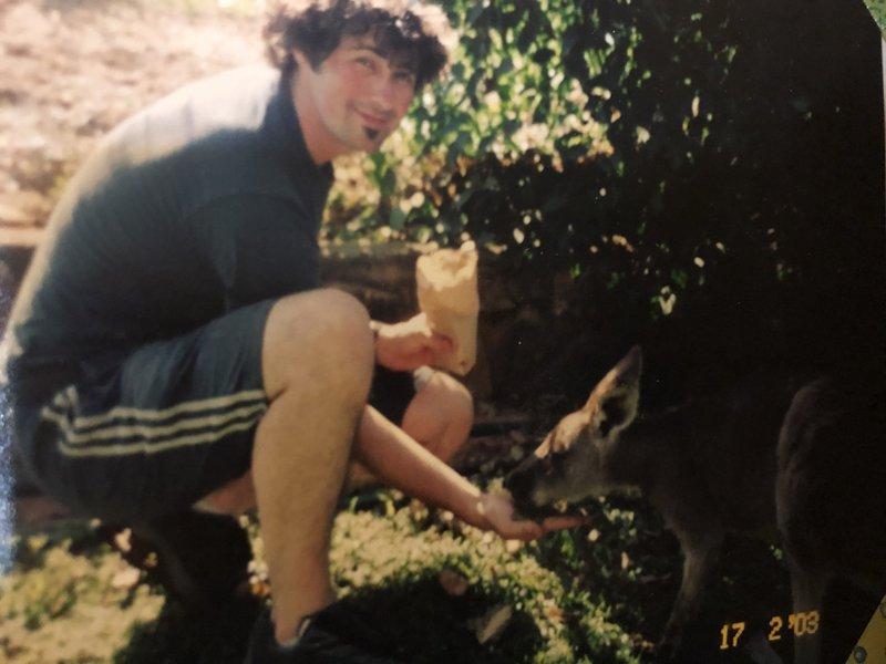 Paul in Australia in 2003 making friends with a kangaroo.  I miss my dear friend Pauly.