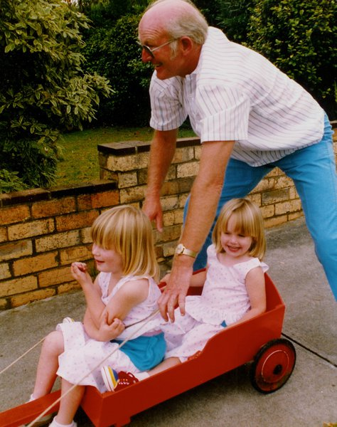 Bill playing with his grandchildren