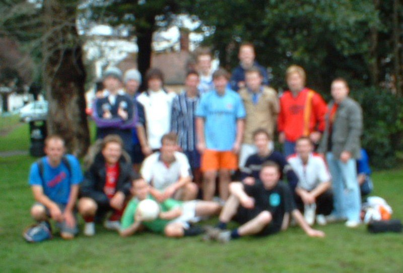 A disappointingly blurry football photo (Reg is in  a navy top kneeling next to Rich's orange shorts!)