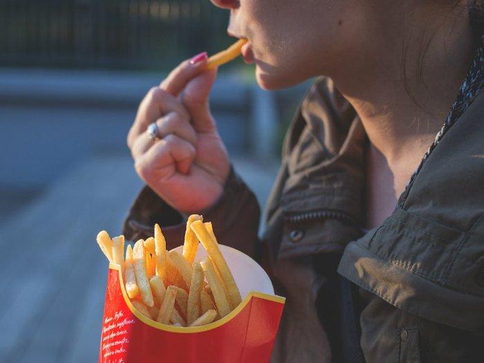 Woman grief eating junk food