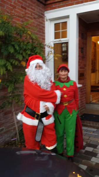 Father Christmas with his elf. 2014
