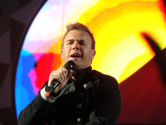 Gary Barlow, patron of Child Bereavement UK, singing live in concert with Take That