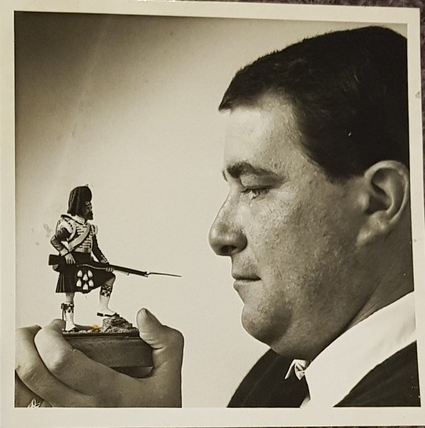 Our dad with one of his figure models he painted.