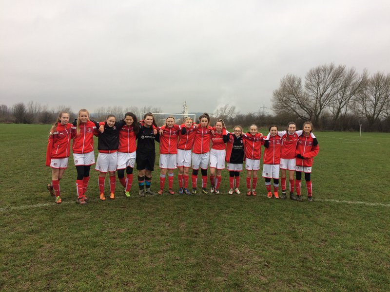 Rotherham United Whitehill Girls before a minutes applause for Stuart a true fan and supporter.