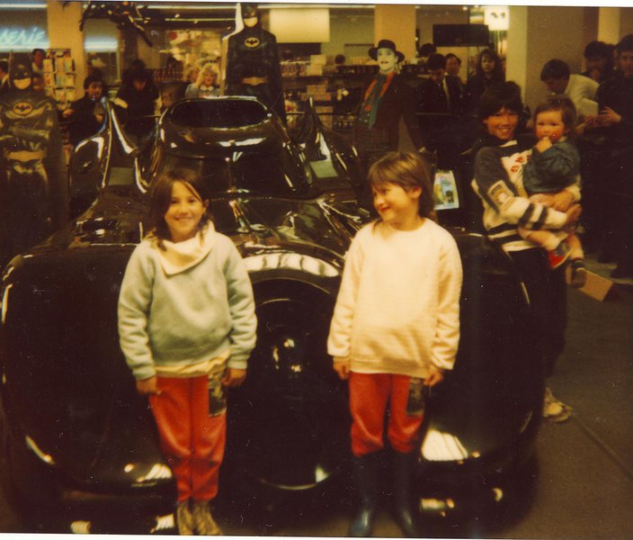 Mel and I excited to be next to the Batmobile. Bear excited to be wearing the same pants as her big sister.