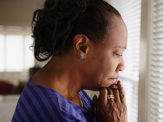 Woman grieving the death of her ex-spouse
