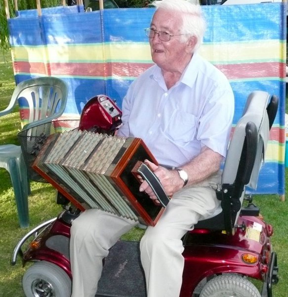 Jim with his dad's accordian, entertaining friends and relatives.