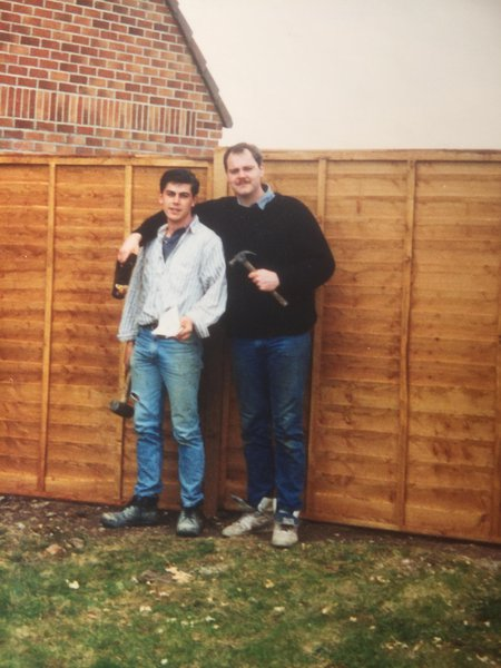 Jim and Karl posing by the fence my mum and I put up.  1991 ish