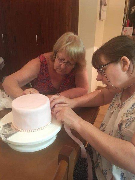 Alison helping me with Sally's wedding cake