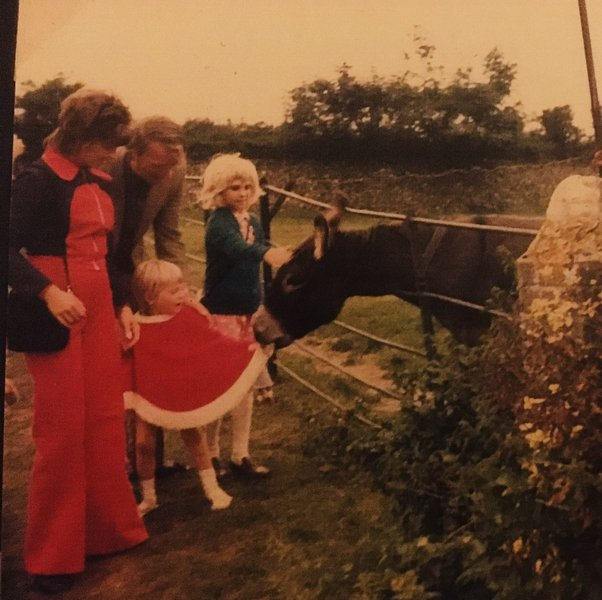 Early 1970s -Poncho chewing donkey :-)  A day we've always remembered