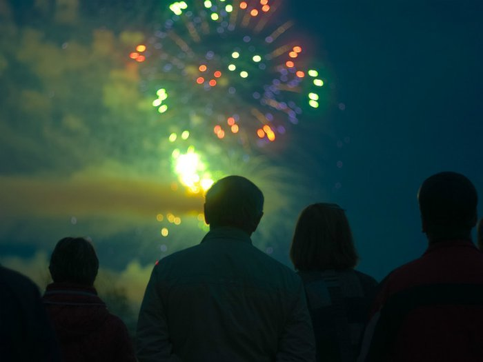 Family watching ashes being scattered in a firework display