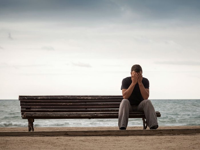 Dad grieving alone on a bench on Father's Day