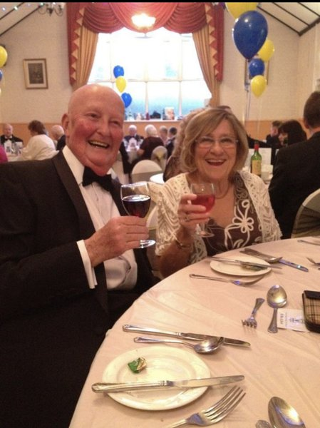 Mum and Dad raising a glass at a Ladies Night.