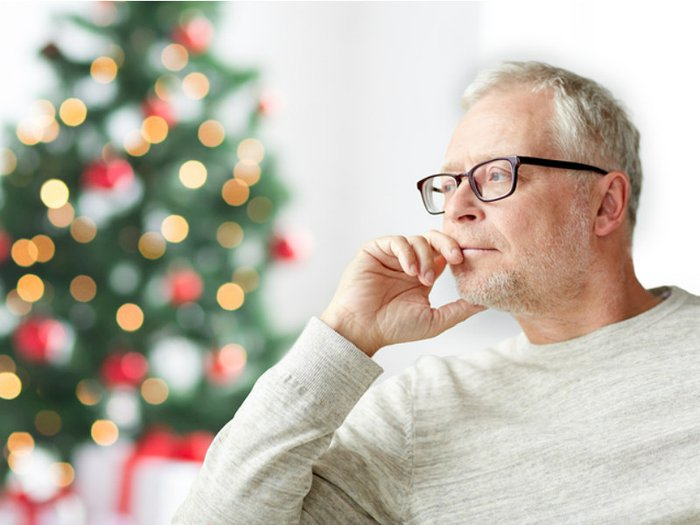Man alone and grieving during Christams