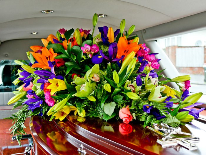 beautiful funeral flowers on coffin