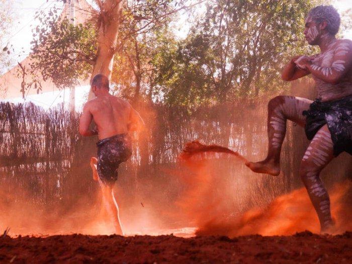 Two Aboriginal dancers perform a ceremonial dance