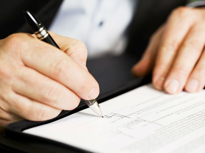 signing a funeral plan