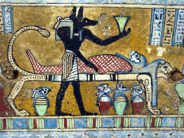 Anubis presides over a mummified body