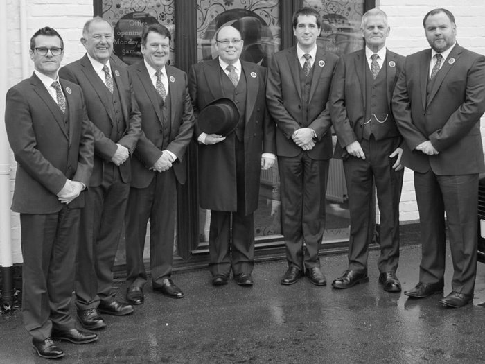 Funeral director Simon Helliar-Moore, centre, and the Crescent Funeral Services team