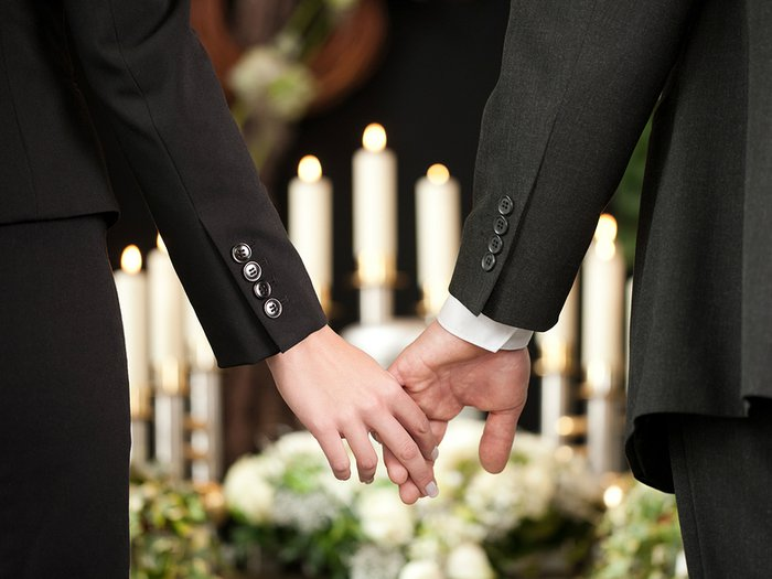 Mourners holding hands