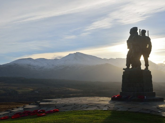 Photo of Commando memorial with poppy wreaths in front of it