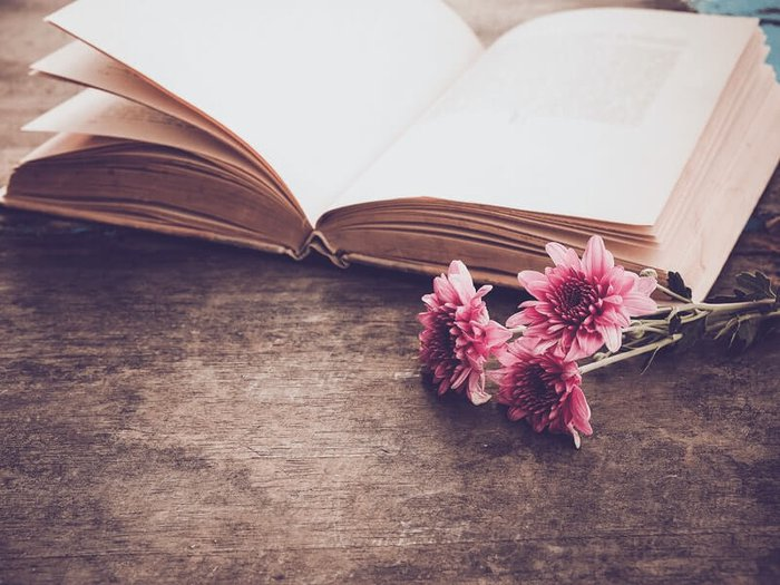 Open book of funeral quotes; memorial quotes for a funeral