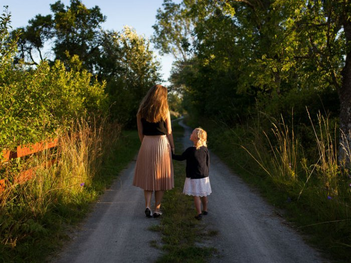 Woman and child walking to funeral