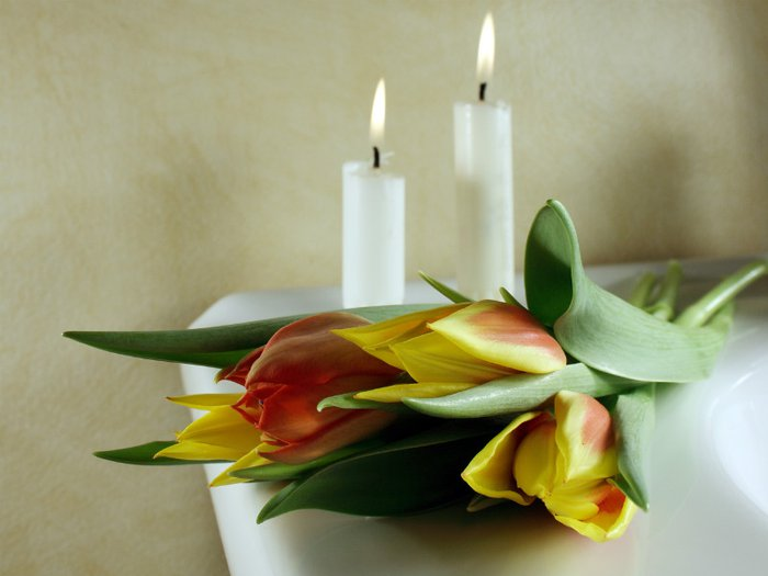 Candles and flowers at a Humanist funeral service