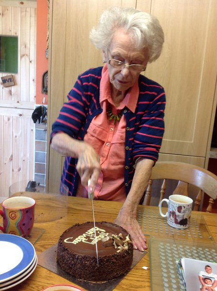 here she is with her Birthday cake.  Hope our dog used to help her unwrap her parcels.