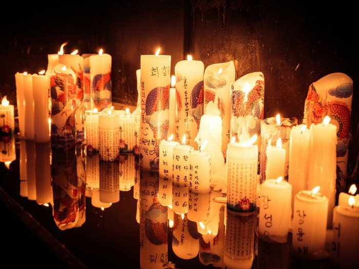 Chuseok Candles lit in offering to those who have died. Photo by Jrwooley6