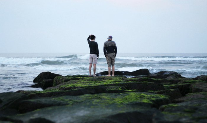Two people looking out to sea