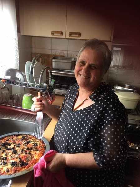 Mum in her kitchen making her famous pizza