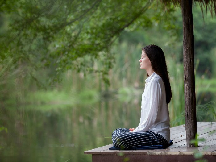 Bereaved woman practising mindfulness for grief