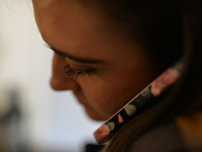 Volunteer listening on the phone to a grieving parent who needs support