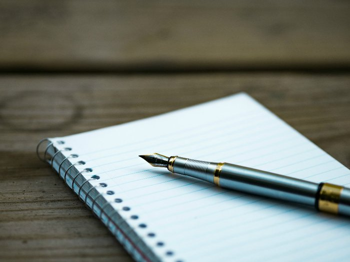 Pen and paper for writing your own obituary