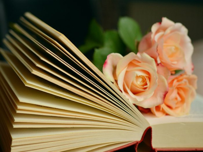 Roses on top of a book of funeral poems