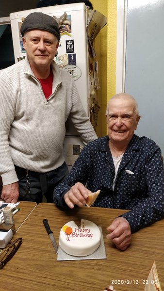 Albert looking pleased with himself on his 92nd birthday next to Ray in Bert's flat cap. 😘