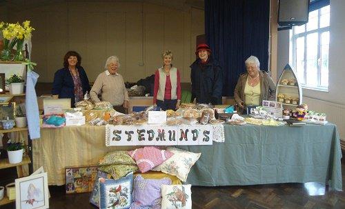 Mum running one of St Edmund's stalls