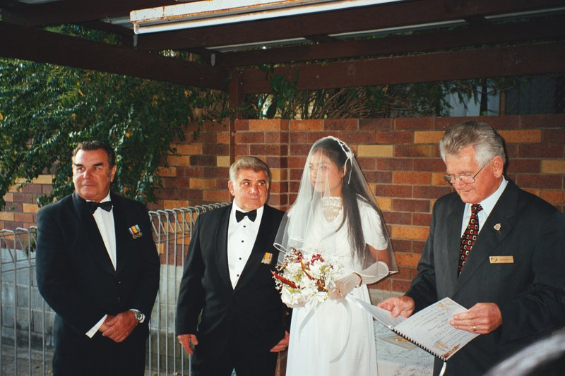 The Best Man with his eye on the Best Bridesmaid,a long time ago.