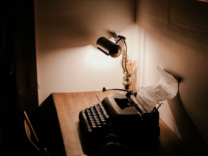 an old fashioned typewriter with a document