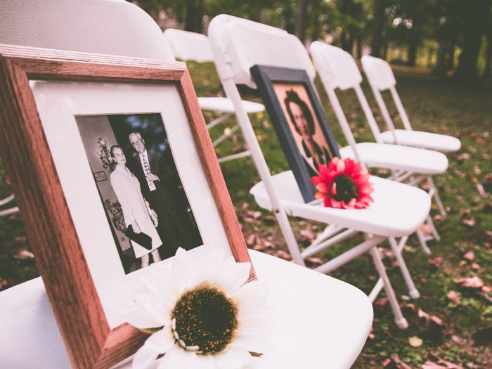 Photos and flowers set out on chairs in memory of someone
