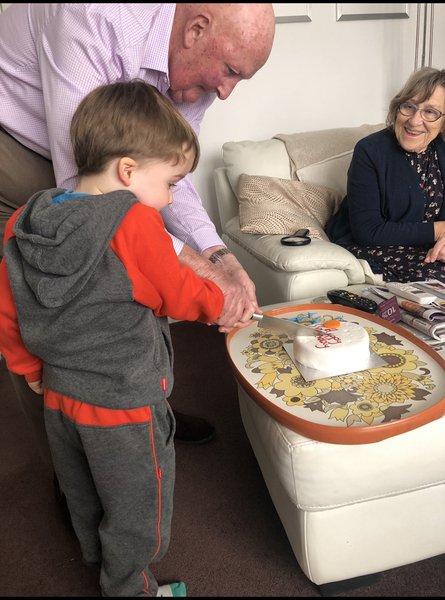 Helping Thomas cut his birthday cake