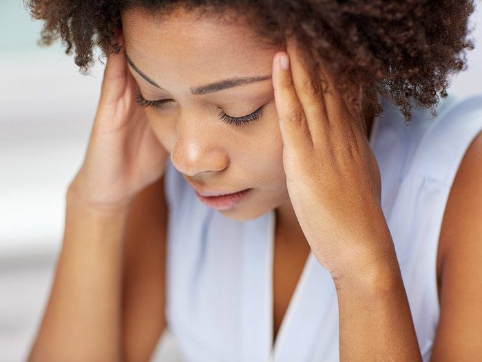 Woman suffering from physical symptoms of grief