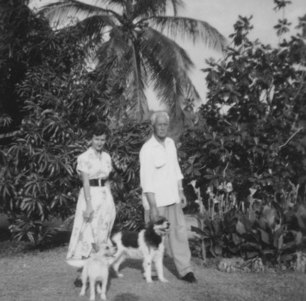 In the garden in Jamaica with her Dad and dogs 1953