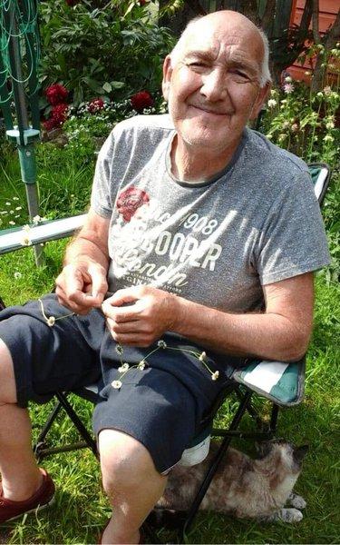 My beautiful dad making daisy chains